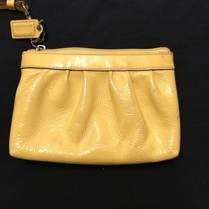 Coach Bags - ⭐️ 2/$20 Coach Yellow Patent Leather Wristlet